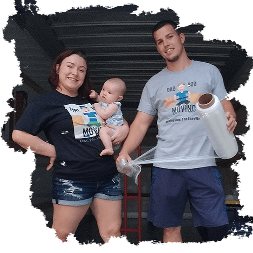 both owners of Dad Bod Moving company and their baby standing at the edge of a moving truck
